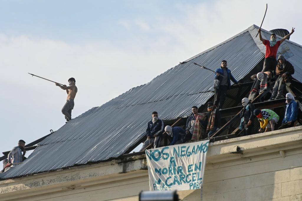 Inmates from Villa Devoto prison take part in a riot demanding measures to prevent the spread of the Covid-19 coronavirus, after a case was reported inside the detention center, in Buenos Aires