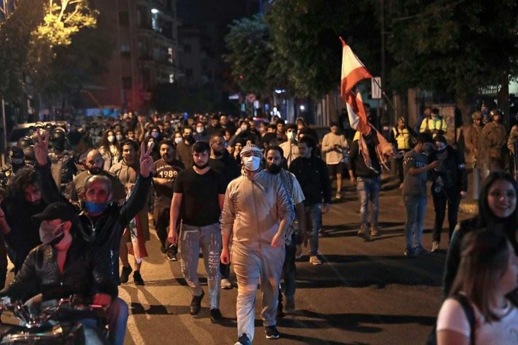 Lebanese demonstrators walk through the streets of the capital Beirut as anger over a spiralling economic crisis re-energised a months-old anti-government movement