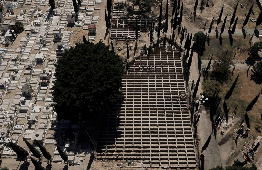 Workers build 700 graves at the Mezquitán Pantheon cemetery in preparation for possible victims of the novel COVID-19 coronavirus in Guadalajara, Mexico