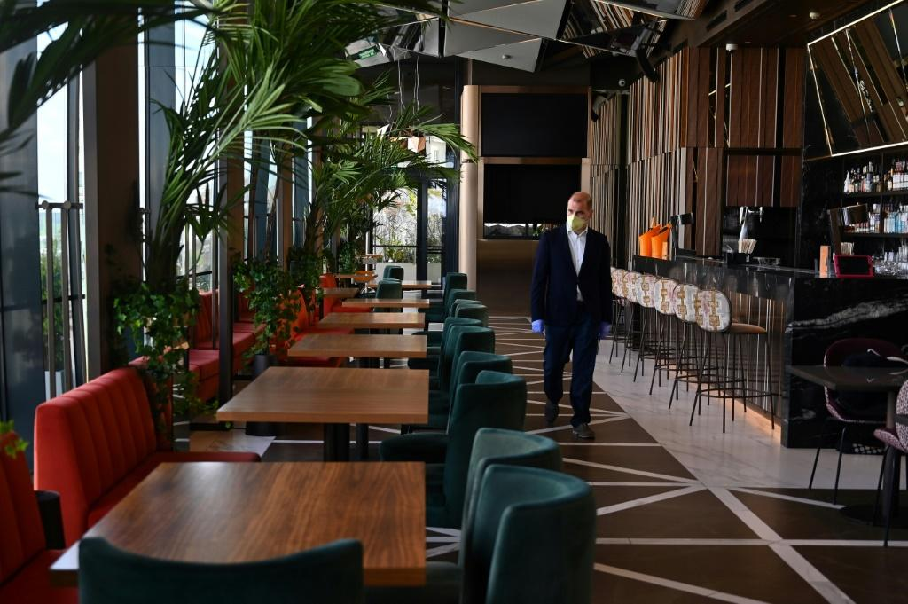 Restaurants may have to cut dining capacity by half