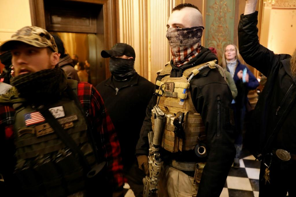 Armed protestors try to enter the chamber of the Michigan State Capitol in Lansing during a rally organized by Michigan United for Liberty demanding the reopening of businesses
