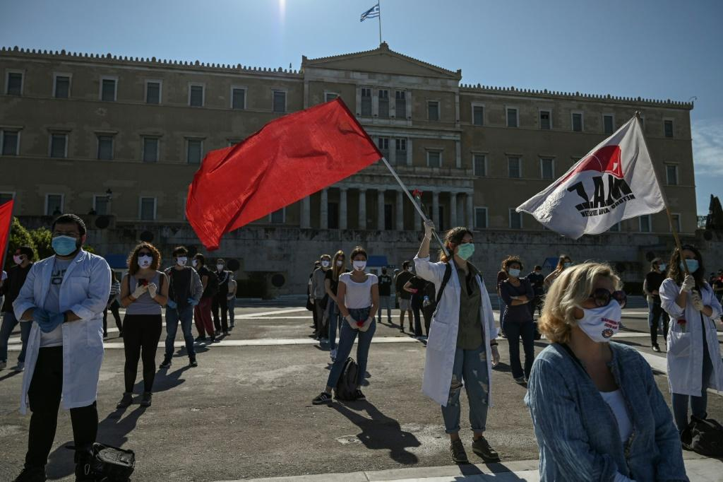 Demonstraters in Athens marked May Day while wearing protective masks and respecting social distancing