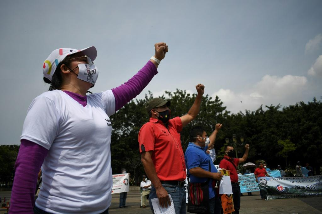 Workers wear face masks during a May Day protest in Guatemala City