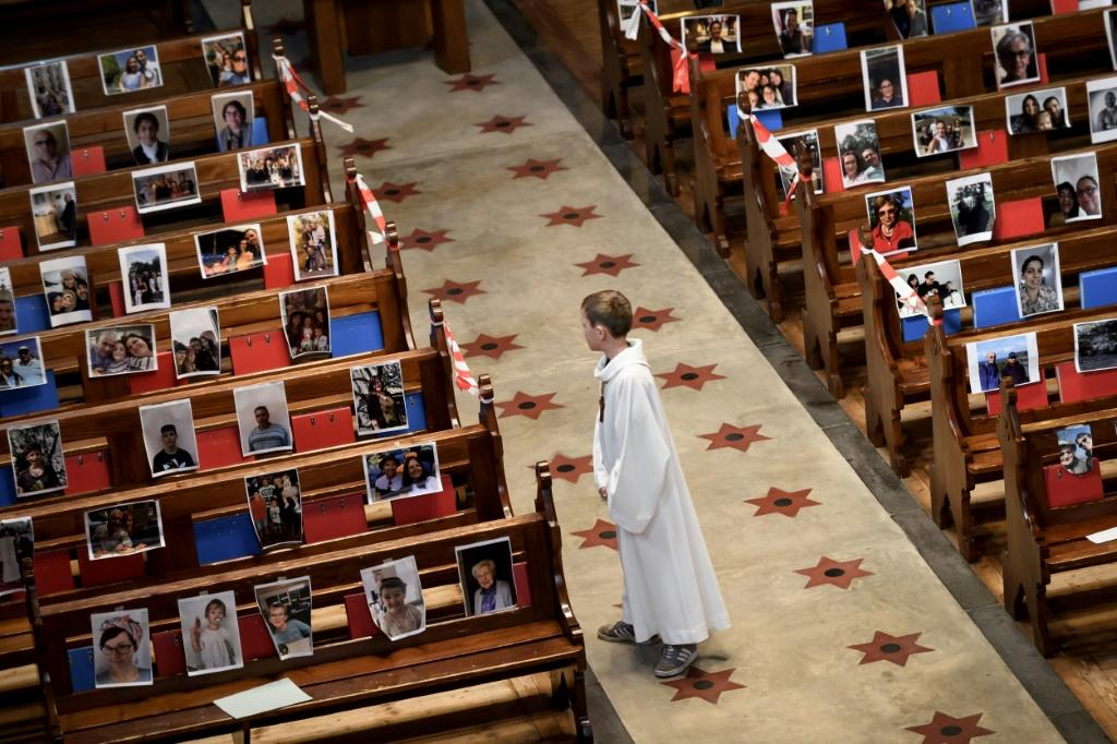 Some churches have filled the pews with pictures of worshippers as people are forced to stay away from prayers together