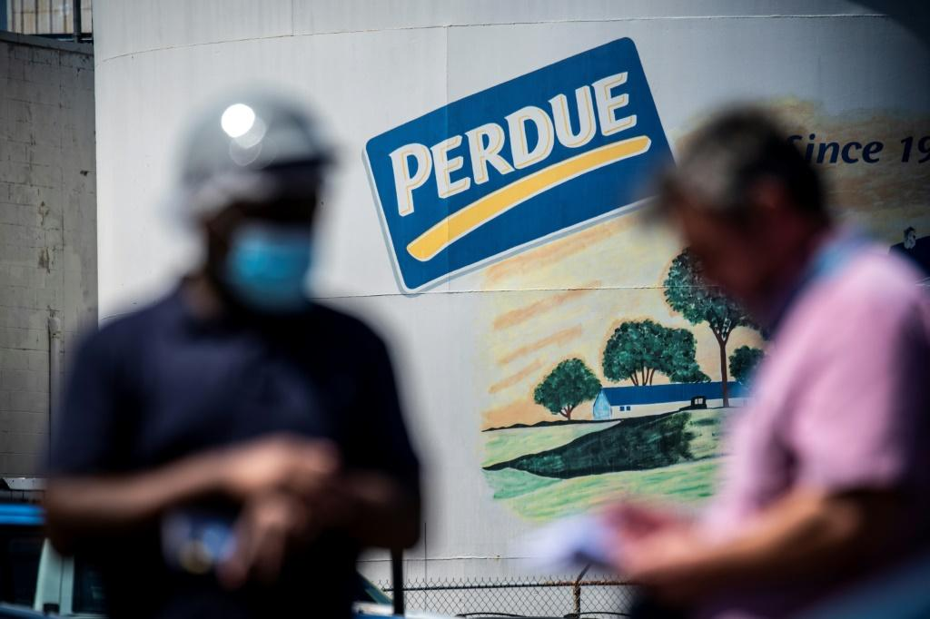 A recently recruited employee who wants to stay anonymous outside the Perdue Farms Chicken and poultry processing factory in Salibury, Maryland, where Haitian workers are fearful of catching the coronavirus at work