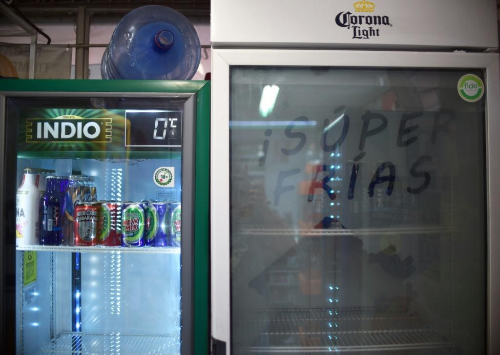 Store refrigerators, such as this one in Mexico City on May 5, are empty with beer-making deemed a non-essential activity during the coronavirus pandemic