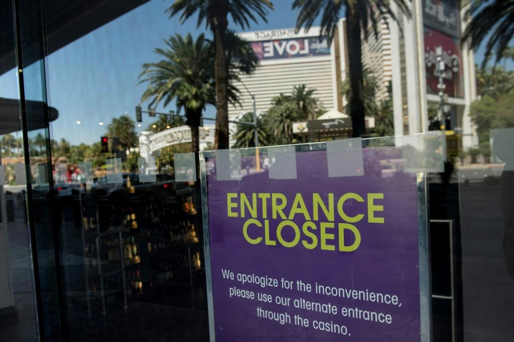 A casino entrance is closed along the Las Vegas Strip, where the financial pain of the pandemic-induced shutdown is clear