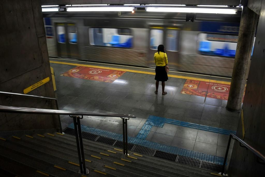 A woman stands at the Sumare subway station during the COVID-19 pandemic in Sao Paulo, Brazil