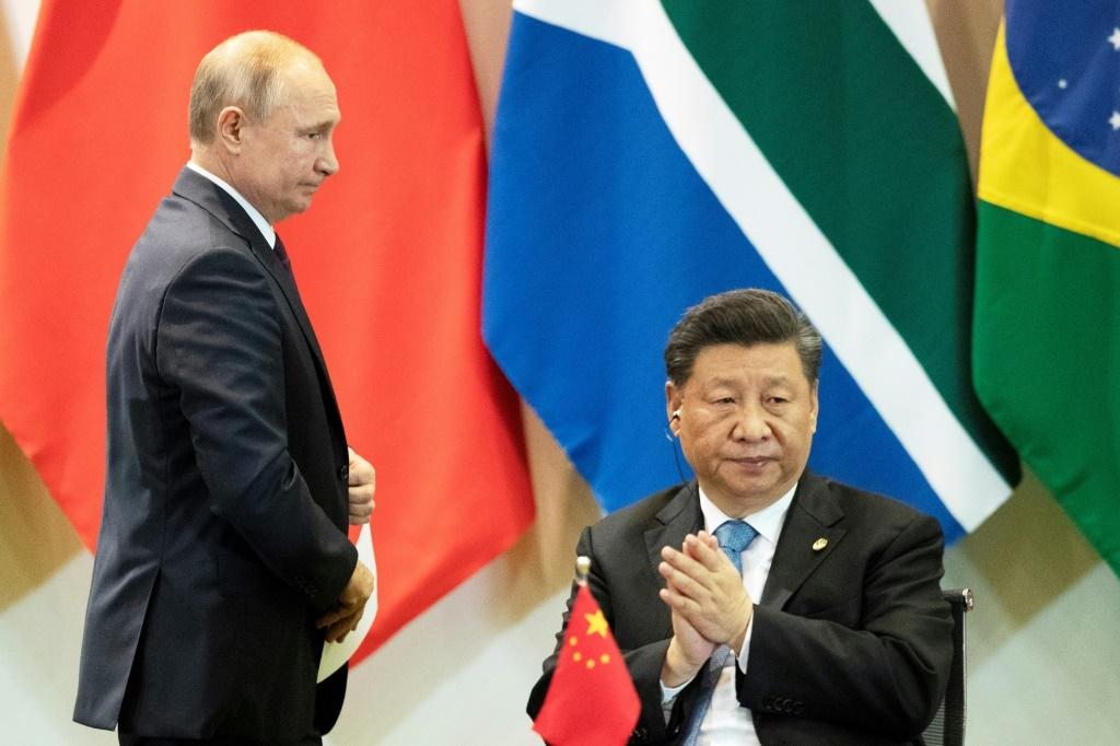 China's President Xi Jinping and Russia's President Vladimir Putin attend a summit of the BRICS major emerging economies in Brasilia in November 2019
