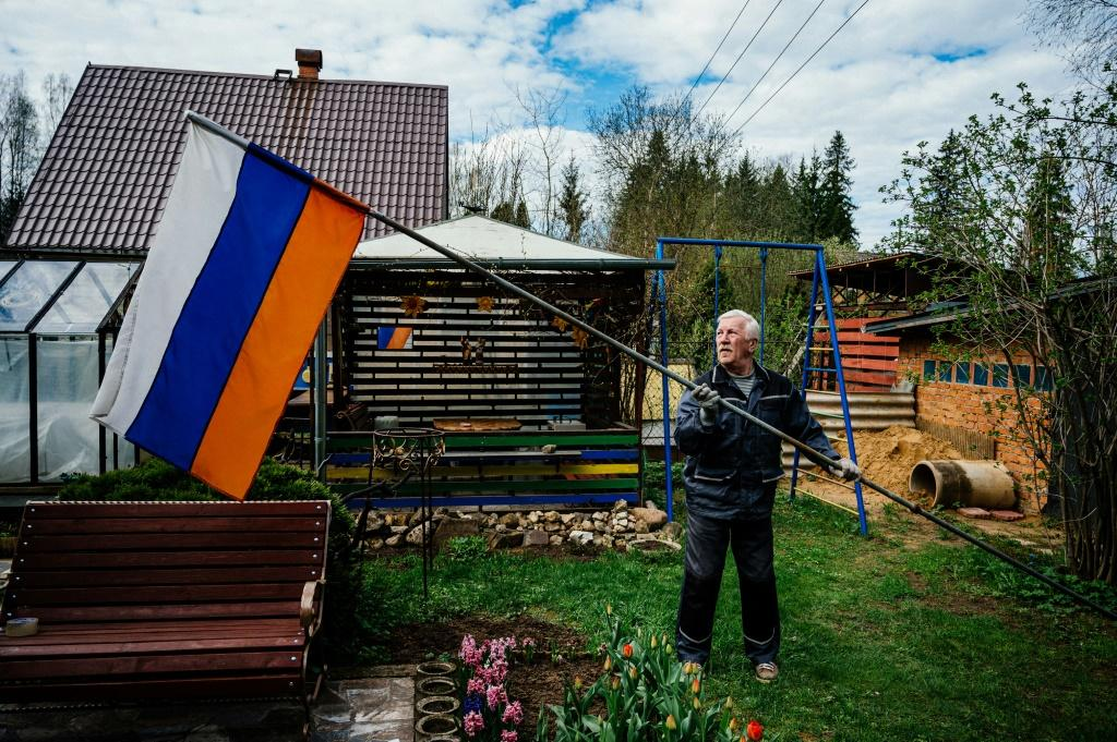 Despite the coronavirus putting limitations on official celebrations, Gennadiy Matveyev kept up his long tradition of raising the Russian flag to commemorate victory over Nazi Germany
