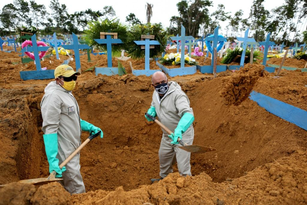 Workers dig graves at Nossa Senhora Cemetery in Manaus, Brazil on May 8 amid the coronavirus pandemic