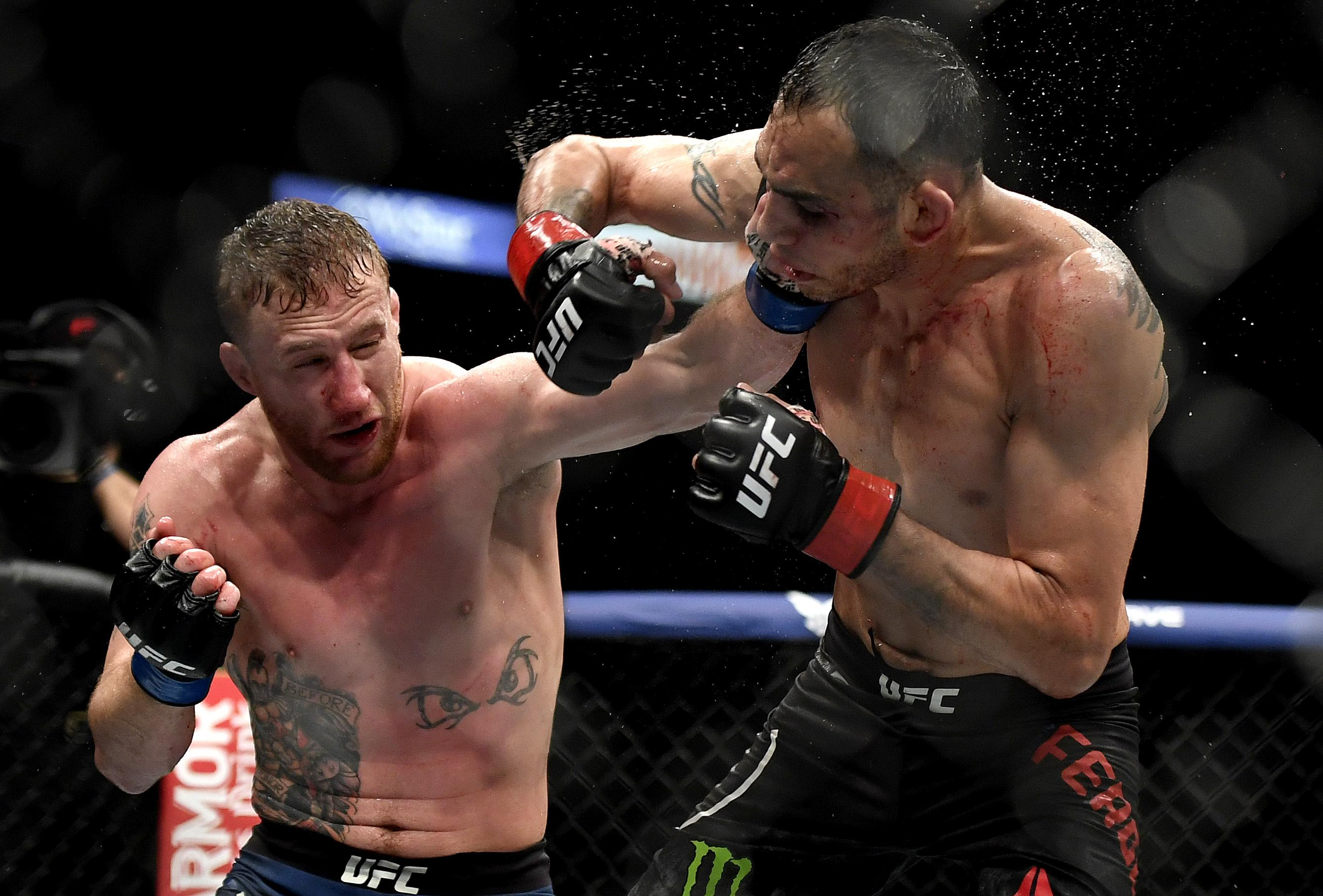Justin Gaethje (L) of the United States punches Tony Ferguson (R) of the United States in their Interim lightweight title fight during UFC 249 at VyStar Veterans Memorial Arena