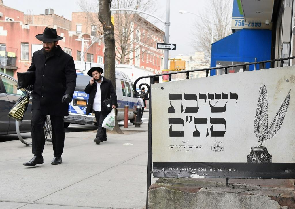 (FILES) In this file photo Orthodox Jewish men walk in the Brooklyn neighborhood of Crown Heights on February 27, 2019 in New York. The United States saw a record number of anti-Semitic incidents last year, including a sharp spike in physical attacks, the