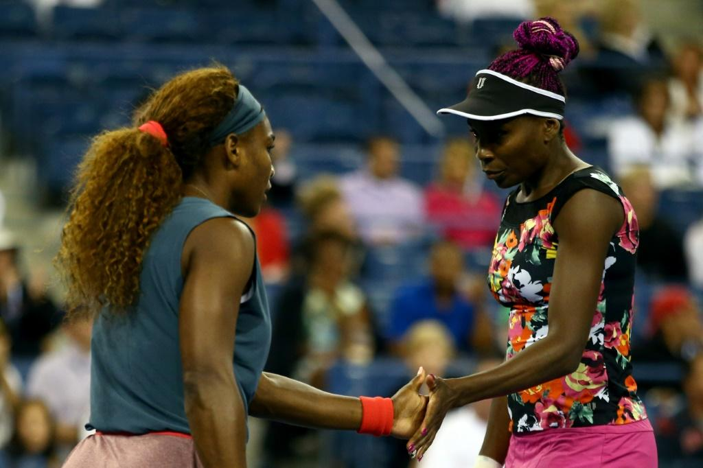 Serena Williams and Venus Williams, seen here playing doubles at the 2013 US Open, teamed up in an Instagram live workout offering keep-fit tips during coronavirus quarantine