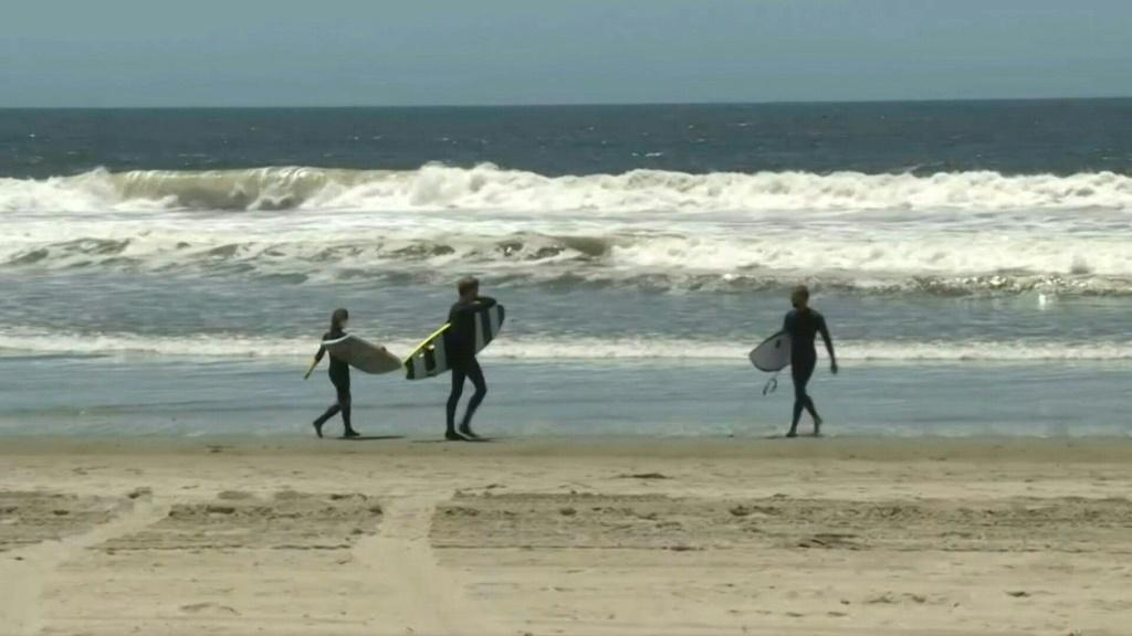 IMAGES Footage of Venice Beach as Los Angeles County beaches reopen for activities including swimming, surfing, running and walking, while sunbathing or picnicking are forbidden amid the coronavirus pandemic.