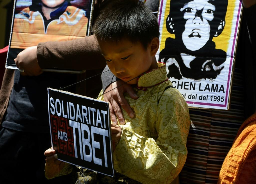 Protesters hold pictures of the missing Panchen Lama recognized by the Dalai Lama in a 2013 demonstration outside the Chinese consulate in Barcelona