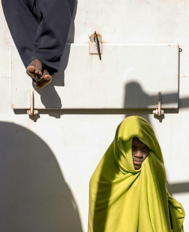 Two migrants are pictured on board the Aita Mari vessel in February after their rescue in international waters