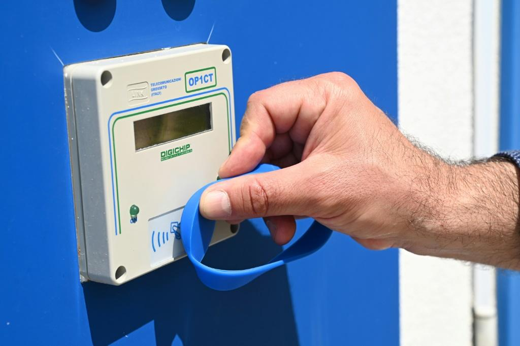 Customers may use electronic bracelets to enter sanitised bathrooms at a private beach in Jesolo, near Venice