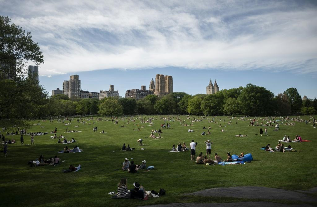 New Yorkers, practicing social distancing, enjoyed spring weather in Central Park, though authorities limited access to prevent contagion