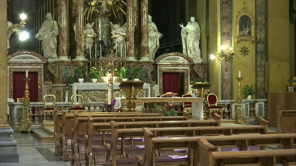 IMAGESChurches reopen in Rome as images from inside Santa Maria in Transpontina's church near the Vatican show worshippers returning to pray.