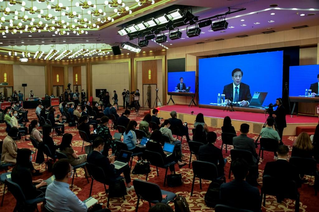 Zhang Yesui, seen here on the screen during a video press conference in Beijing on May 21, 2020, said China's parliament considered the move necessary