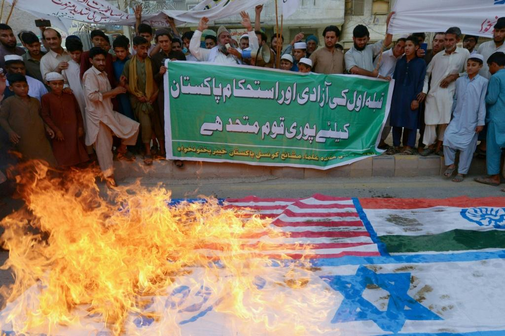 Iran cancelled this year's Quds (Jerusalem) Day rallies in the face of the coronavirus but in the Pakistani city of Peshawar protesters burnt Israeli, US and Indian flags