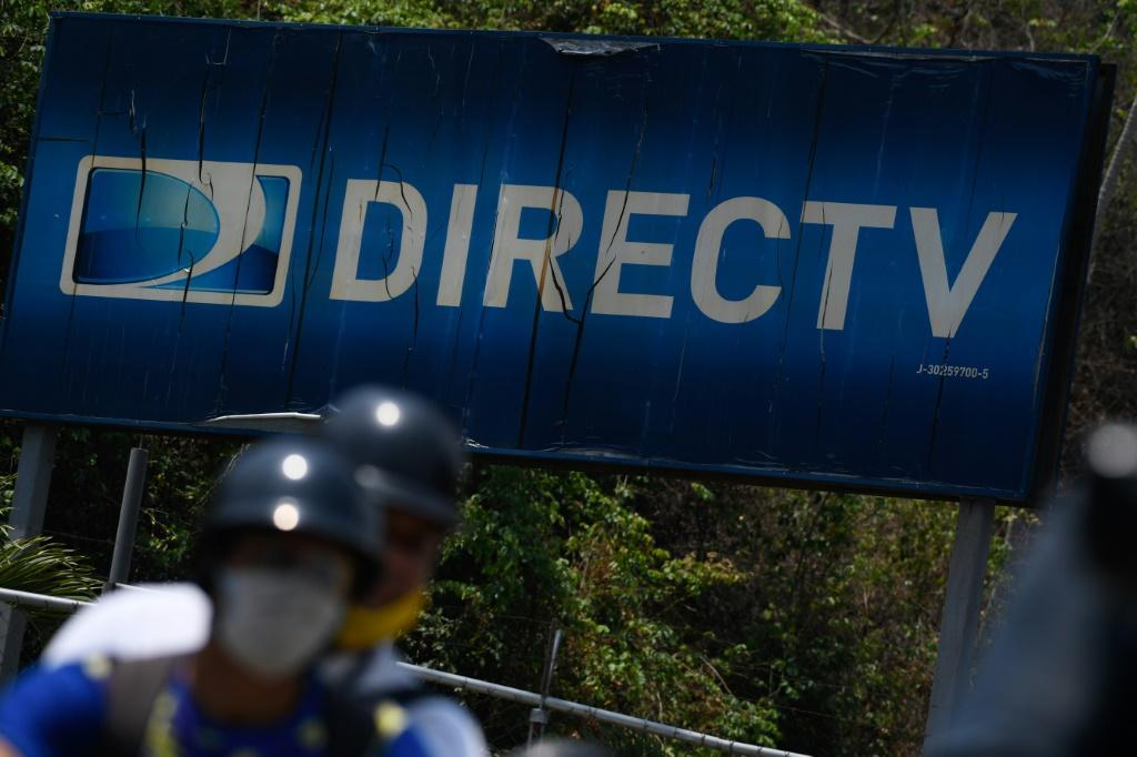 "The DirecTV logo at its headquarters in Caracas on May 19, 2020: US telecoms giant AoT&T has annunced its ""immediate"" withdrawal from the pay television market in Venezuela, where it offered the DirecTV satellite platform, due to the impossibility of comp"