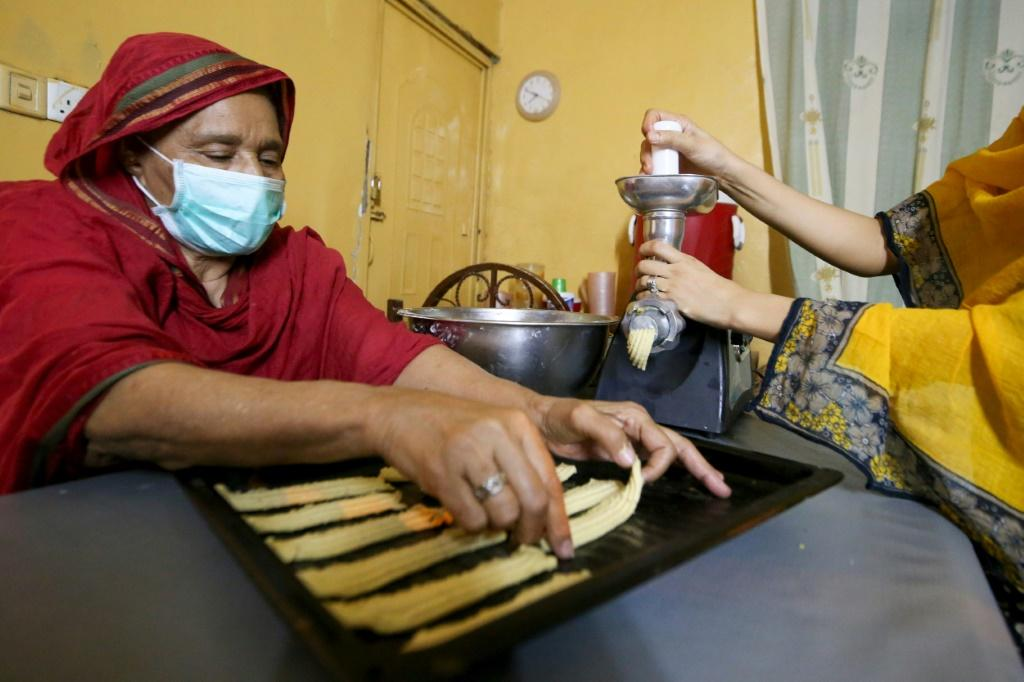 A Sudanese family prepare traditional biscuits at their home in the capital Khartoum just ahead of Eid