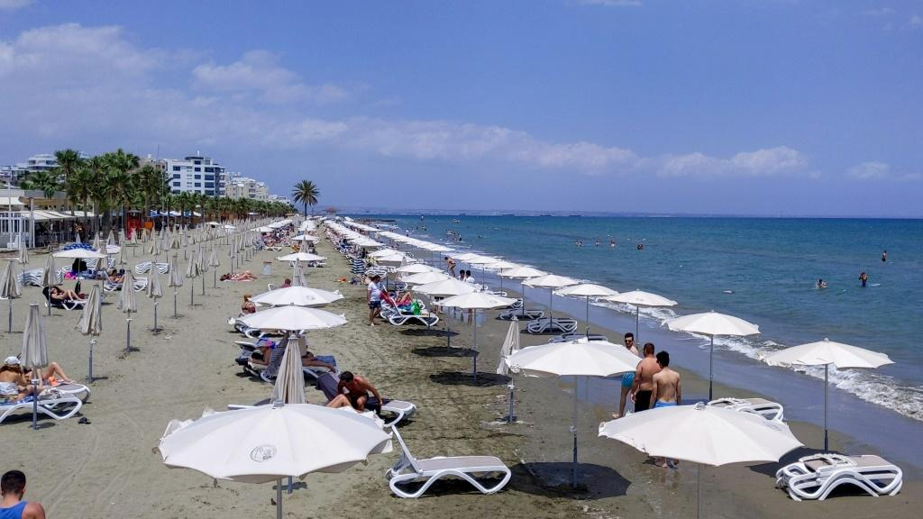 People enjoy sun and surf at Mackenzie beach in the coastal city of Larnaca on the Mediterranean island of Cyprus on May 23, 2020