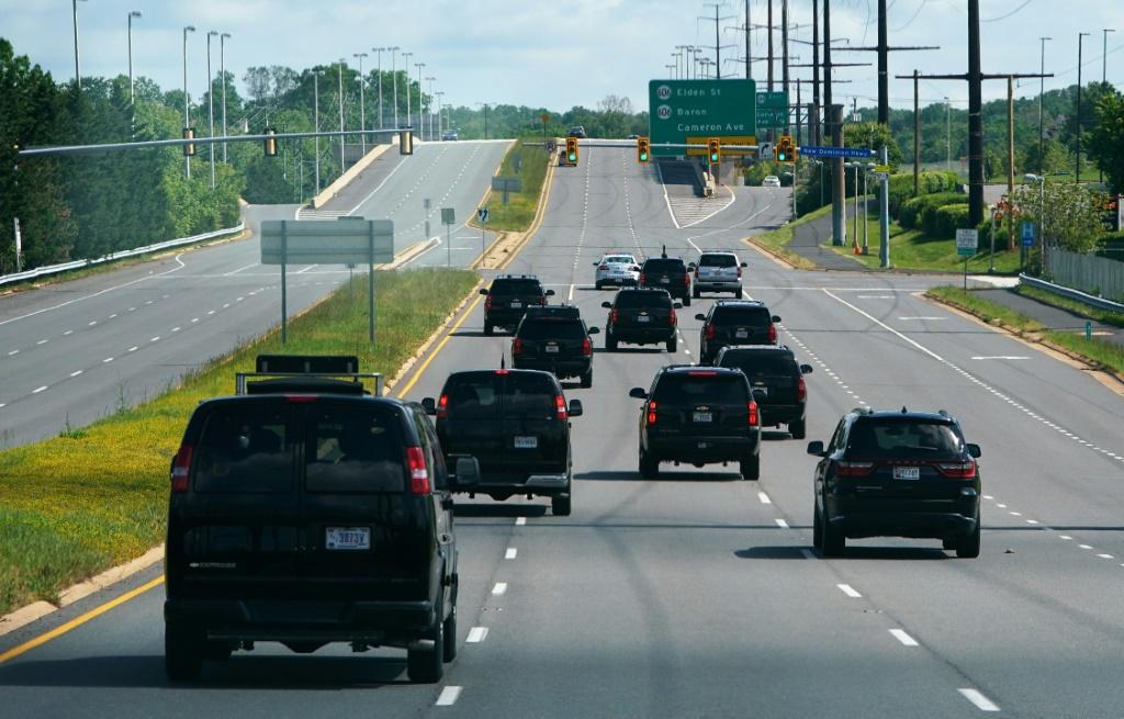 The motorcade carrying US President Donald Trump travels through Reston, Virginia on May 23, 2020.