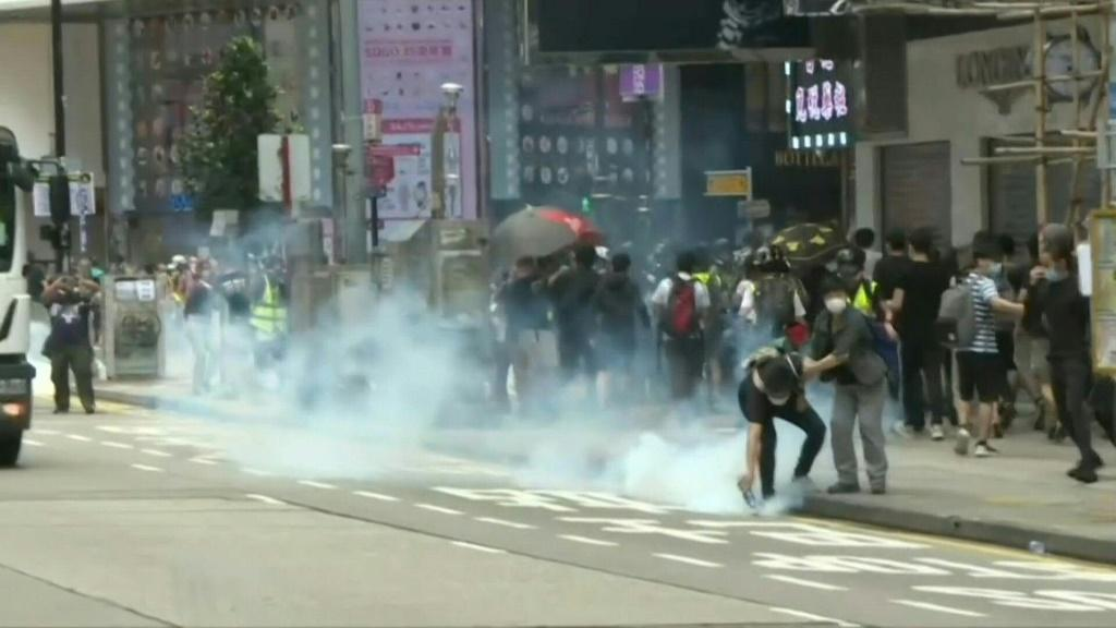 IMAGES Police fire tear gas to disperse a crowd of pro-democracy protesters. Hong Kong has been hit by a fresh round of demonstrations after China proposed new security law feared to halt the freedoms enjoyed by the city.