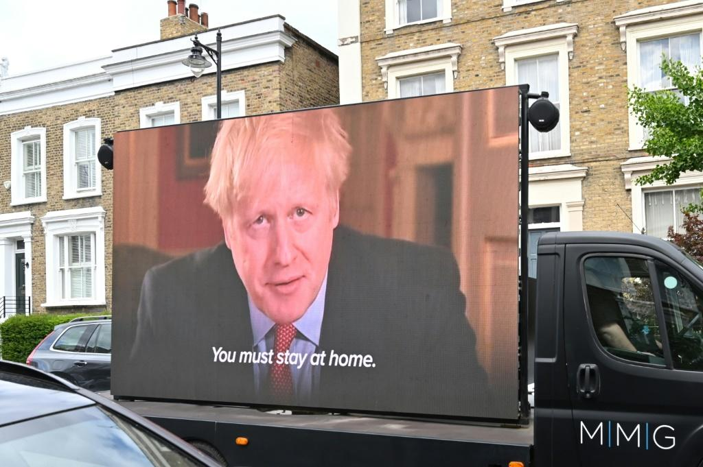 A screen on a truck showing Johnson outlining the rule that Cummings is accused of breaking