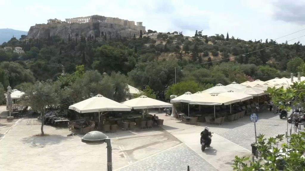 IMAGES Tavernas, bars and cafes reopen in Athens as Greece eases restrictions imposed to stem the spread of the coronavirus.