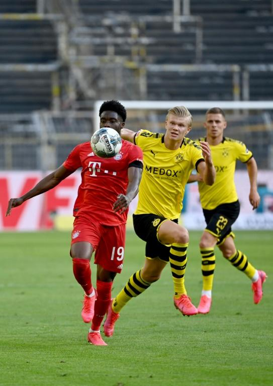 Dortmund's Norwegian forward Erling Braut Haaland (C) had a frustrating time against the Bayern defence.