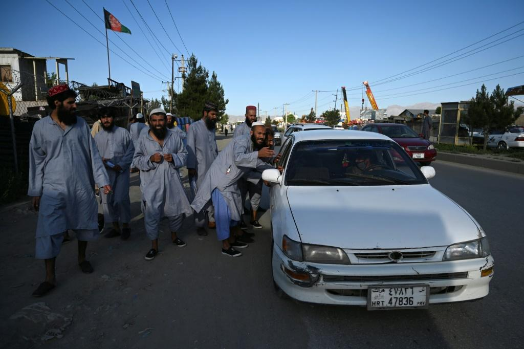 Each former Taliban prisoner was given the equivalent of about $65 in Afghan currency -- upon reaching Kabul by bus, some flagged taxis to get to their homes