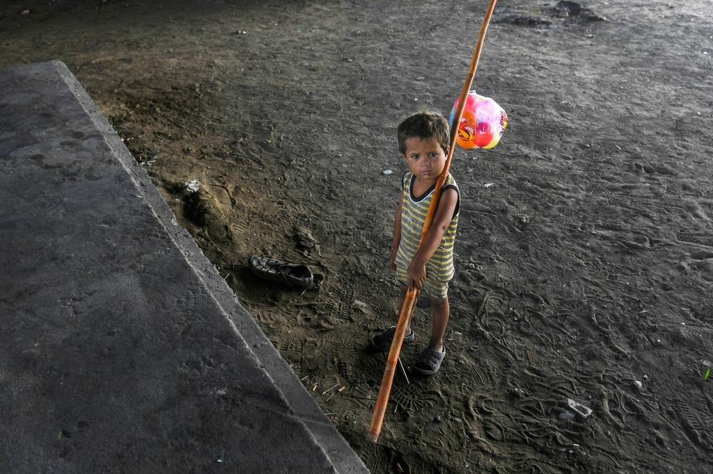 A child is seen in Karachi, Pakistan -- the majority of children at risk of poverty live in South Asia and sub-Saharan Africa, but the coronavirus pandemic will see a surge in Europe and Central Asia, a study shows