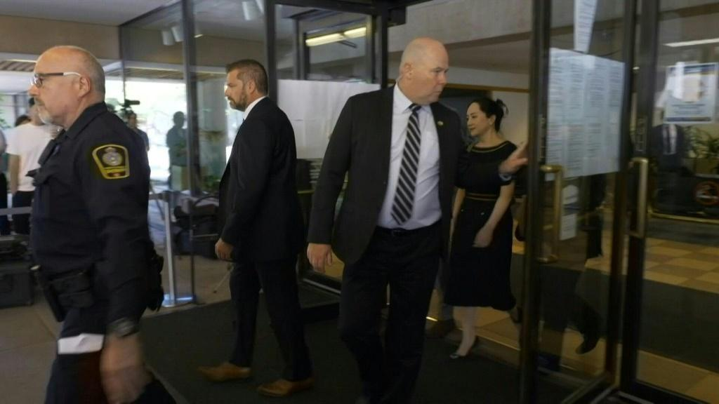 Chinese Huawei executive Meng Wanzhou leaves British Columbia Supreme Court after she was dealt a legal setback, as a Canadian judge ruled that proceedings to extradite her to the United States will go ahead.