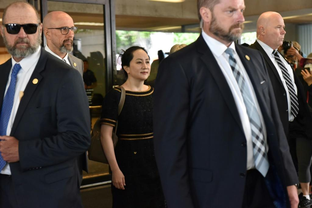 Huawei Chief Financial Officer, Meng Wanzhou (C), leaves British Columbia Supreme Court, after hearing the decision of Associate Chief Justice Heather Holmes on her double-criminality judgment in Vancouver, on May 27, 2020