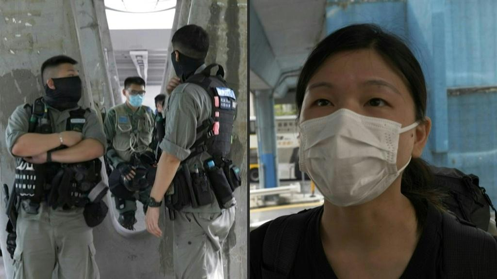 """Hong Kong riot police stop and search people downtown ahead of a debate at the city's legislature over a law that would ban insulting China's national anthem. """"You can see there's police every corner, it's like martial law in force"""", says one person a"""