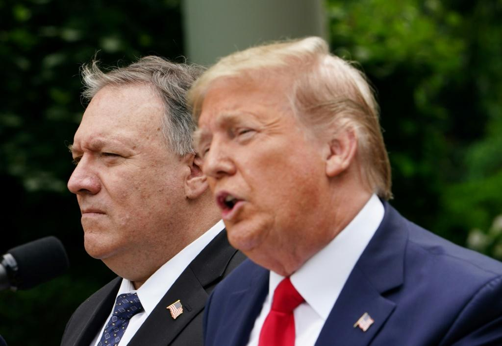 US President Donald Trump, with US Secretary of State Mike Pompeo, holds a press conference on China in the White House Rose Garden