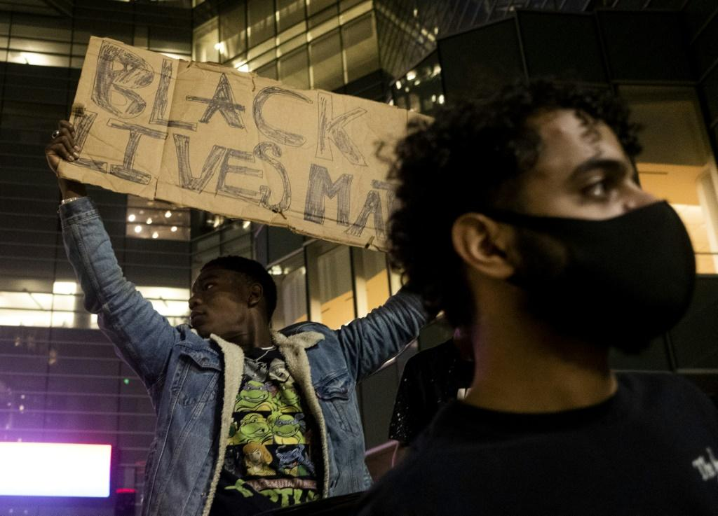 Protesters in Detroit rally over the death of 46-year-old George Floyd at the hands of police in Minneapolis, Minnesota