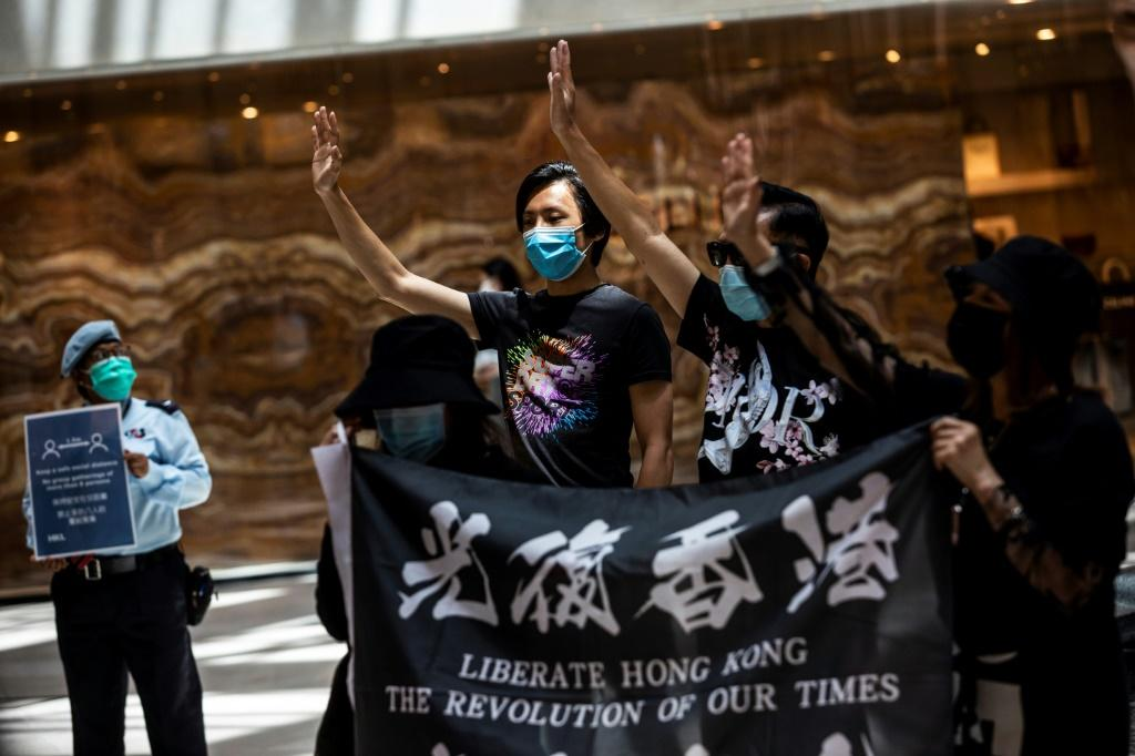 Pro-democracy protesters gather during a rally at a shopping mall in Hong Kong on June 1, 2020. China has accused Washington of double standards in how it has views action by protesters in HK and the US