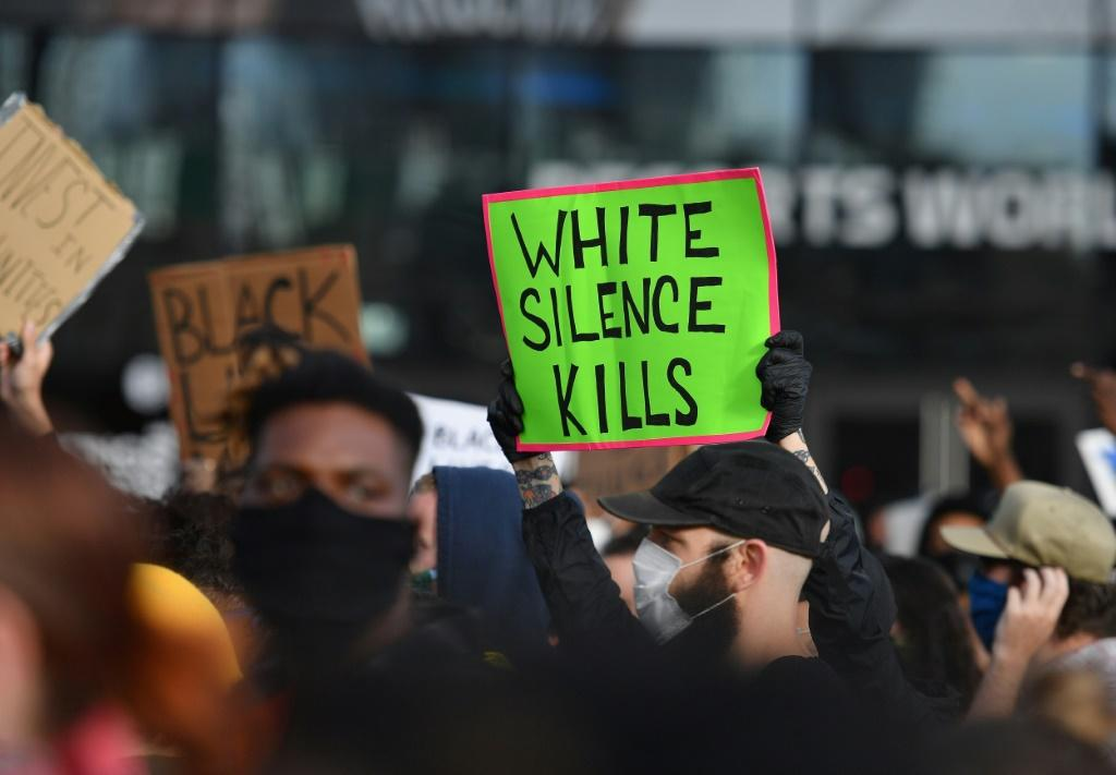 Protestors hold up placards during a Black Lives Matter demonstration in New York over the death of George Floyd