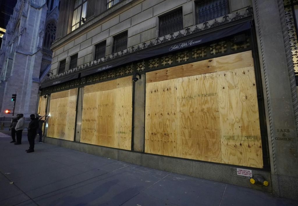 Saks on Fifth Avenue was boarded up after a night of looting in New York city