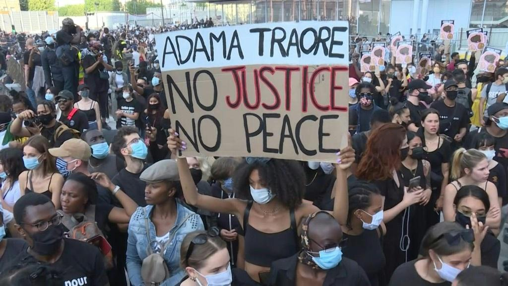 Thousands of demonstrators gather in front of the Paris High Court to show solidarity for George Floyd in the US and call for justice for Adama Traoré, a 24-year-old black man who died in police custody in France in 2016.