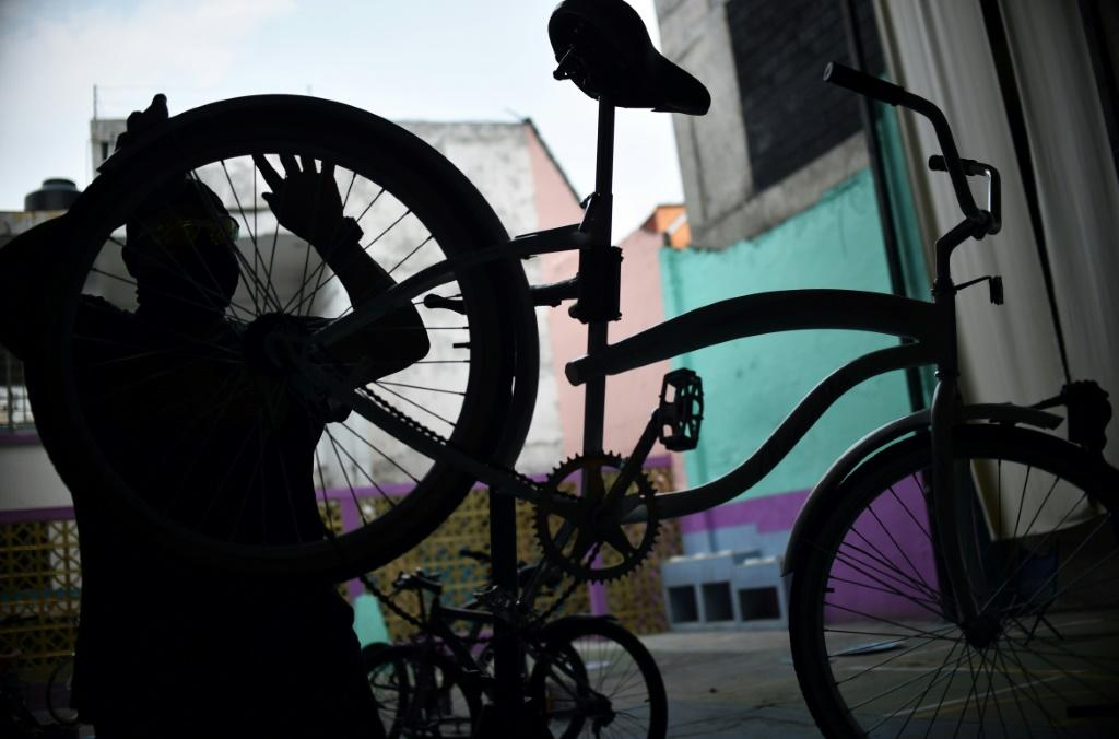 Activists at the Bicitekas organization repair and assemble bicycles to be donated to medical personnel in Mexico City