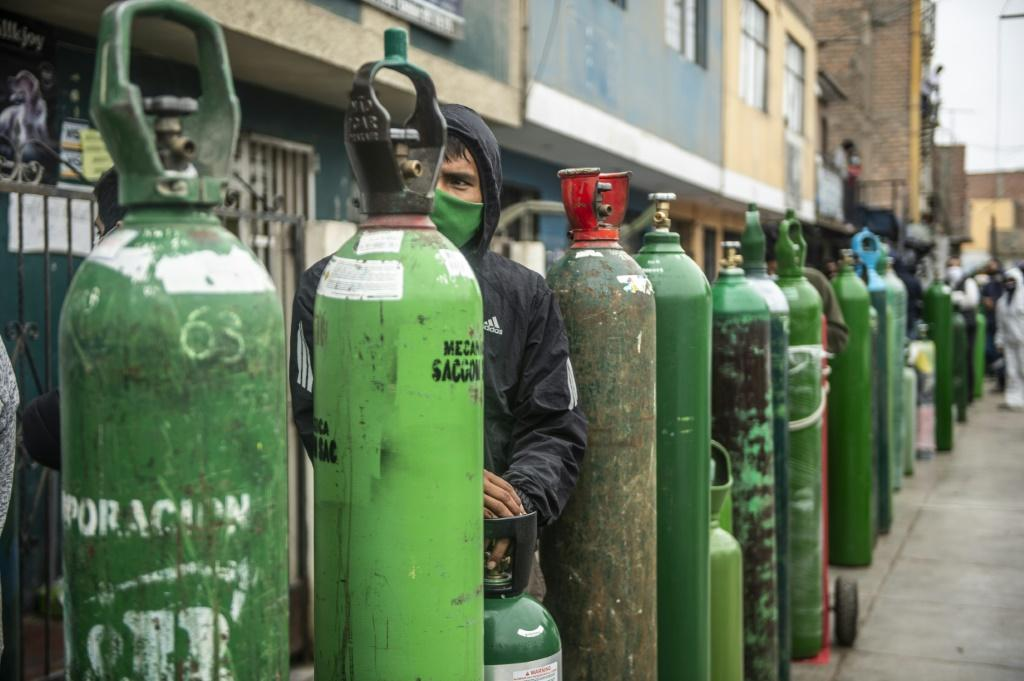 Desperate residents in Peru were lining up to buy oxygen tanks