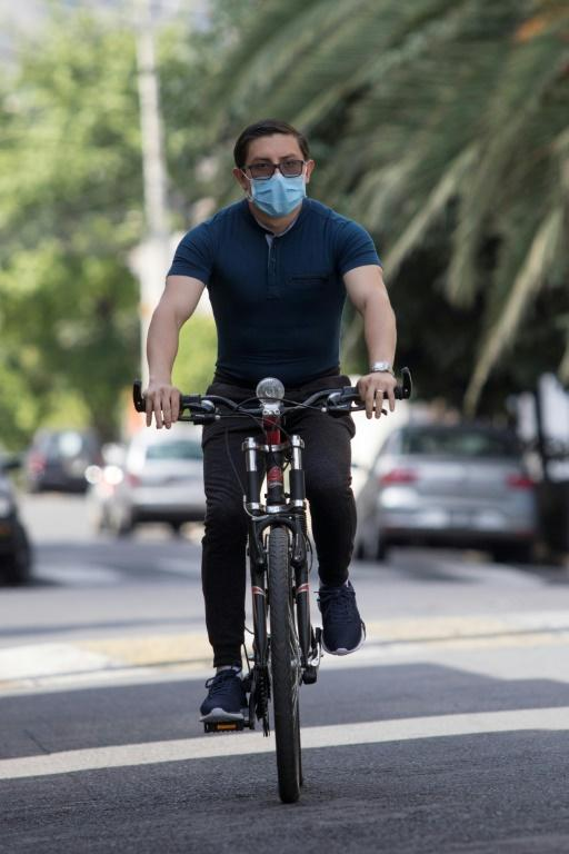 Diego Villafuerte, a doctor at the Jesus Hospital in Mexico City rides on the bike he was given by the Bicitekas foundation