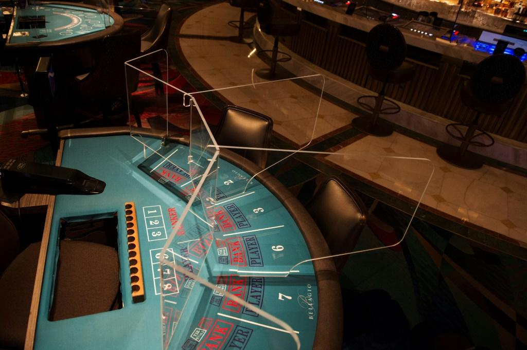 Welcome to the new normal: a transparent partition separates players at a table game at the Bellagio Hotel and Casino in Las Vegas