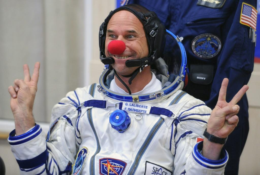 Canadian space tourist and Cirque du Soleil founder Guy Laliberte jokes during space suit testing prior to his blast off in 2009